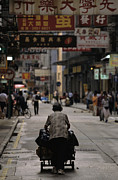 City Streets Framed Prints - An Elderly Woman Pushes A Cart Framed Print by Justin Guariglia
