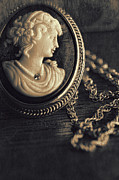 Memory Photos - Antique cameo medallion on wood by Sandra Cunningham
