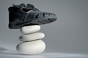 Sami Sarkis - Baby shoe on stack of pebbles