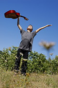 Sami Sarkis - Boy standing in meadow with guitar
