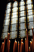 Stained Glass Windows Posters - Candles burning in front of a stained glass window in the Auch Cathedral Poster by Sami Sarkis
