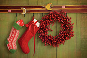 Stocking Posters - Christmas stockings and wreath hanging on  wall Poster by Sandra Cunningham