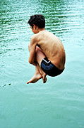 Knees Prints - Diving into water Print by Sami Sarkis