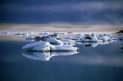 Icebergs Photos - Floating icebergs reflected in the quiet waters of Jokulsarlon by Sami Sarkis