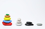 Sami Sarkis - Four growing stacks of multi-colored...