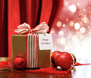 Giving Prints - Gold Christmas gift box and ornaments with sparkle lights  Print by Sandra Cunningham