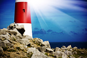 Simon Bratt Photography - Lighthouse on rocks with light beams