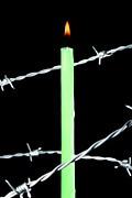 Barbed Wire Fences Acrylic Prints - Lit candle surrounded by barbed wire Acrylic Print by Sami Sarkis