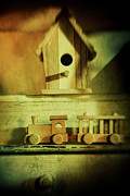 Hobbies Prints - Little wooden train on shelf Print by Sandra Cunningham