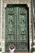 Destinations Digital Art Posters - Man picturing main entrance door of Florence Duomo Poster by Sami Sarkis