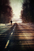 Snowy Road Posters - Man walking on a rural winter road Poster by Sandra Cunningham