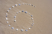 Sami Sarkis - Pebbles arranged in spiral shape on...