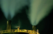 Oil Refinery Photo Posters - Petroleum refinery chimneys at night Poster by Sami Sarkis