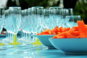 Dining Table Posters - Raw carrots and empty glasses Poster by Sami Sarkis