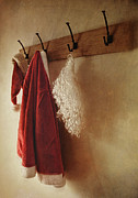 Hook Prints - Santa costume hanging on coat rack Print by Sandra Cunningham