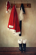 Jacket Photo Posters - Santa costume with boots on coathook Poster by Sandra Cunningham