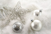 Wish Prints - Silver holiday ornaments in feathers Print by Sandra Cunningham