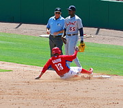 Phillies Photo Prints - Sliding to 3rd Print by Carol Christopher