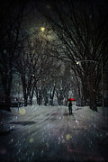 Snowy Night Posters - Snowy winter scene with woman walking at night Poster by Sandra Cunningham