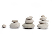 Sami Sarkis - Stacks of pebbles on white background