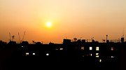 Simon Bratt Photography - Sunset over rooftops with building...