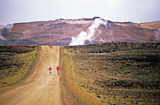 Dirt Roads Photos - Two bikers on a dirt road leading to a geothermal power station at Myvatn by Sami Sarkis