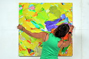 Art Product Framed Prints - Woman adjusting a painting Framed Print by Sami Sarkis