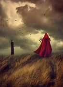 Sandra Cunningham - Woman with red cape walking in sand...