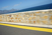Yellow Line Framed Prints - Yellow line on a coastal road by sea Framed Print by Sami Sarkis