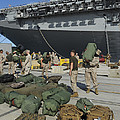 Marines Move Gear During An Embarkation by Stocktrek Images