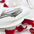 Romantic Dinner Setting With Rose Petals by Elena Elisseeva
