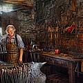 Mike Savad - Blacksmith - Working the...