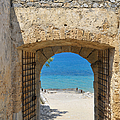 Door to joy and serenity - beautiful blue water is waiting Print by Matthias Hauser