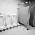 full length urinals and cubicles in mens toilet of High school canada north america by Joe Fox