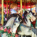 Susan Savad - Little Boy on Carousel