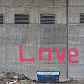 Love - pink painting on grey wall