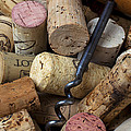 Pile Of Wine Corks With Corkscrew by Garry Gay