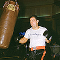 Rocky Marciano Working Heavy Bag by Retro Images Archive