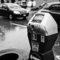 water soaked coin and credit card parking meter on the streets of downtown Vancouver BC Canada by Joe Fox