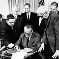 President Lyndon Johnson Signs The 24th by Everett