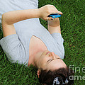 Woman Using Her Iphone by Photo Researchers, Inc.