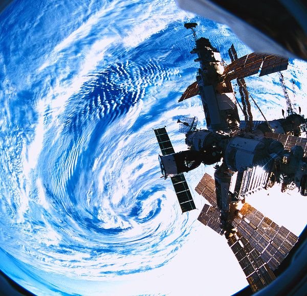 A Space Station Orbiting Above Earth Photograph