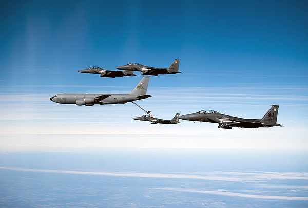 Kc-135 Stratotanker Photograph - A F-15e Strike Eagle Is Refueled by Stocktrek Images