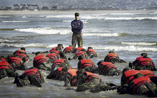 A Navy Seal Instructor Assists Students Photograph