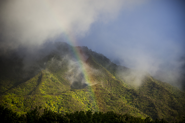 A Rainbow Shines Over The Rugged Photograph