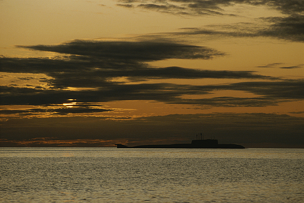 Arctic Ocean Photograph - A Silhouetted Russian Submarine by James P. Blair