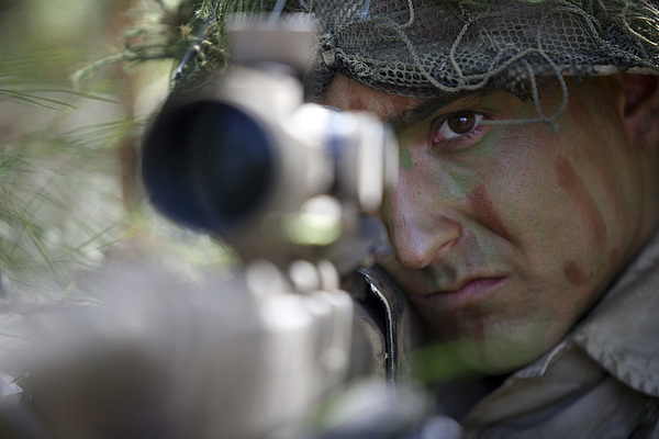 Us Marines Photograph - A Sniper Sights In On A Target by Stocktrek Images