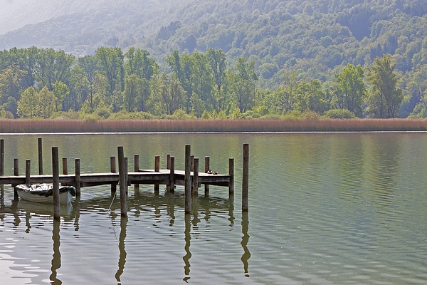 Travel Photograph - A Wooden Pier At A Small Lake by Joana Kruse