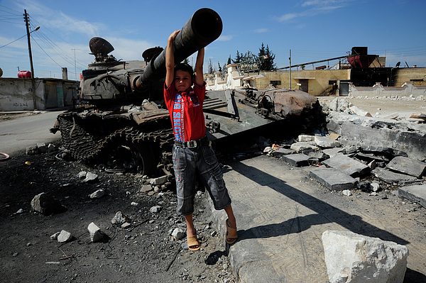 Free Syrian Army Photograph - A Young Syrian Boy Plays On The Turret by Andrew Chittock