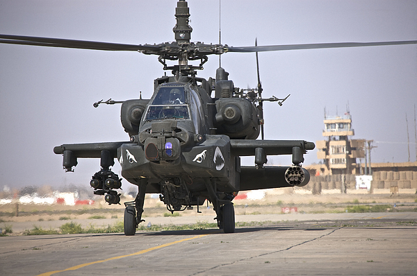 Ah-64 Photograph - An Ah-64 Apache Helicopter Returns by Terry Moore